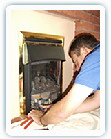 Image of me fitting a gas fire